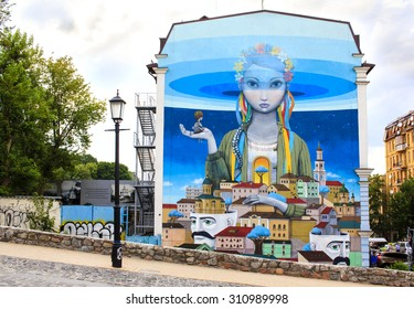 "KYIV, UKRAINE - JULY 7th, 2015 : Beautiful graffiti painting entitled ""Revival"" at Andriyivskyy Descent, so called Montmartre of Kyiv. Painting represents Ukraine as a girl in the national closing."