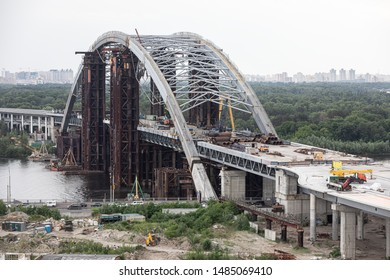 KYIV, UKRAINE - Jun 04, 2019: Construction of the Podolsky bridge  in Kyiv. Construction of traffic artery. Construction of the bridge across the river