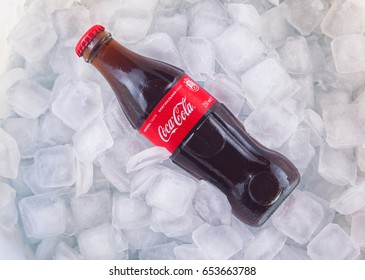 Kyiv, Ukraine - Jun 05, 2017: Can of Coca-cola on a bed of ice and white background, Coca-cola is a carbonated soft drink