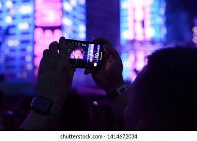 """KYIV, UKRAINE - JUNE 01, 2019: Singer Dmitry Monatik (MONATIK) during the concert """"Love It Rhythm"""" at the NSC """"Olympic"""", in Kiev"""