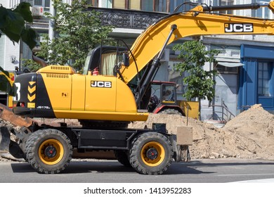 KYIV, UKRAINE - JUNE 02,2019. Pipes are being replaced in the city center using a JCB excavator.