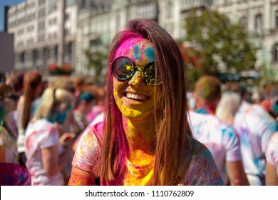 KYIV, UKRAINE - JUNE 10, 2018: Festival Color Run in Kiev, Ukraine. People take part at color run. Young girls and men in paint holi / People sprinkle each other with colored paints at the festival.