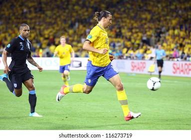 KYIV, UKRAINE - JUNE 15: Striker Zlatan Ibrahimovic of Sweden (in Yellow) control a ball during UEFA EURO 2012 game against England on June 15, 2012 in Kyiv, Ukraine