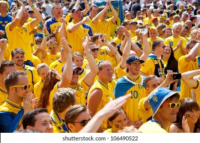 KYIV, UKRAINE - JUNE 15: Sweden and Ukrainian fans arrive in the fanzone before match Euro 2012 between England - Sweden on June 15, 2012 in Kyiv, Ukraine. Zone for the fans UEFA EURO Championship.
