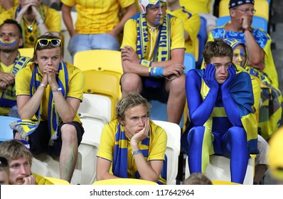 KYIV, UKRAINE - JUNE 15: Swedish soccer fans react after England beat of Sweden in their UEFA EURO 2012 game on June 15, 2012 in Kyiv, Ukraine