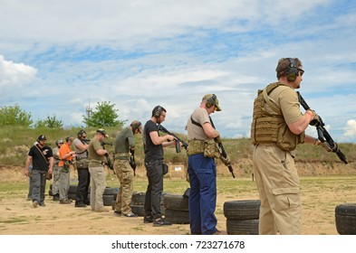 "KYIV, UKRAINE - JUNE 17 2017: The civil men are trained to fire at the outdoor shooting range during ""Open Gun Day"" KYIV, UKRAINE - JUNE 17 2017."