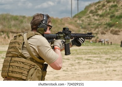 "KYIV, UKRAINE - JUNE 17 2017: The civil man is trained to fire at the outdoor shooting range during ""Open Gun Day""."