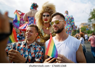 KYIV, UKRAINE - JUNE 18, 2017: Participants take a selfie with rainbow lgbt flag during the Equality March, organized by the LGBT community
