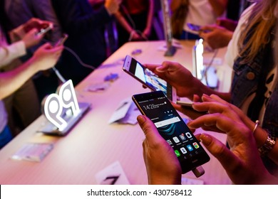 KYIV, UKRAINE - JUNE 2, 2016 : People holds in hands new HUAWEI P9 smartphone on the stand during the official presentation in Hilton Hotel Kyiv, Ukraine.