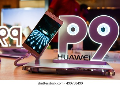 KYIV, UKRAINE - JUNE 2, 2016 : The new HUAWEI P9 smartphone on the stand during the official presentation in Hilton Hotel Kyiv, Ukraine.