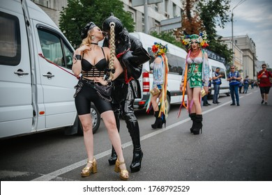KYIV, UKRAINE JUNE 23, 2019 Travesti in BDSM latex dress kiss woman during the Equality March, organized by the LGBT community