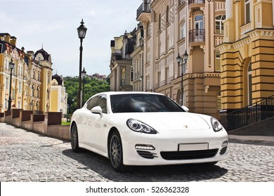 Kyiv, Ukraine, June 25, 2015; Porsche Panamera amidst beautiful buildings. Editorial photo.