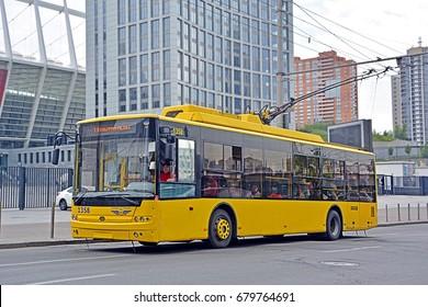 KYIV, UKRAINE - JUNE 29 - A modern low-floor Bogdan 701.10 trolleybus on Shota Rustaveli St, with the Olimpiyskiy Stadium (Olympic Stadium) in the background, on June 29, 2017 in Kyiv (Kiev), Ukraine