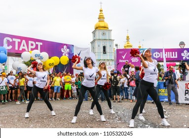 KYIV, UKRAINE - JUNE 3, 2018: Red Foxes cheerleaders team performs during the 26th Kyiv Chestnut Charity Run 2018