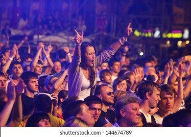 KYIV, UKRAINE - JUNE 30: People dance during Queen performs onstage at charity Anti-AIDS concert at the Independence Square on June 30, 2012 in Kyiv, Ukraine