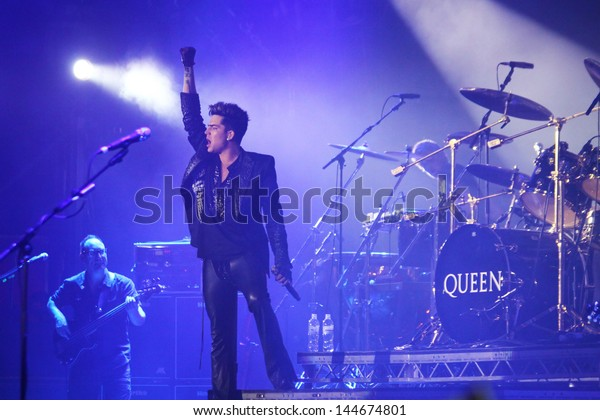 KYIV, UKRAINE - JUNE 30: Queen with Adam Lambert perform onstage during charity Anti-AIDS concert at the Independence Square on June 30, 2012 in Kyiv, Ukraine