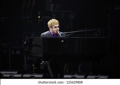 KYIV, UKRAINE - JUNE 30: Singer Sir Elton John performs onstage during charity Anti-AIDS concert at the Independence Square on June 30, 2012 in Kyiv, Ukraine