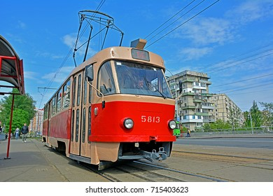 KYIV, UKRAINE - JUNE 30 - Tatra T3 tram standing at a tramway stop, with a Soviet block of flats in the background in the Obolon district, on June 30, 2017 in Kyiv (Kiev), Ukraine
