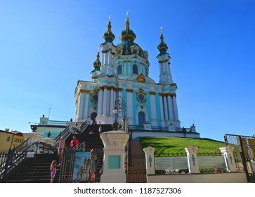 Kyiv, Ukraine - June 9, 2017: The Andrew's church on the Kyiv hills (St Andrew's Church), people walking by Andriyivskyi Descent