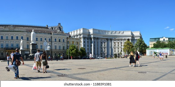 Kyiv, Ukraine - June 9, 2018: Locals and tourists walking near Ministry of Foreign Affairs of Ukraine and Monument to Princess Olga, Saint Andrew, Cyril and Methodius at Mykhailivska Square.