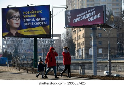KYIV, UKRAINE- March 03, 2019: People walking  near political billboards of Ukrainian candidates of presidential election. Yulia Tymoshenko  on the left, and Ukrainian President Petro Poroshenko