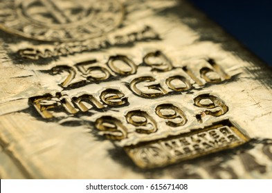 Kyiv, Ukraine - March 07, 2017: the surface of cast gold bullion. Selective focus.  (shallow DOF)