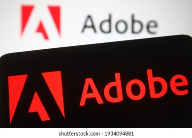 KYIV, UKRAINE - MARCH 10, 2021:  In this photo illustration Adobe Inc. logo of an American multinational computer software company is seen on a mobile phone screen.