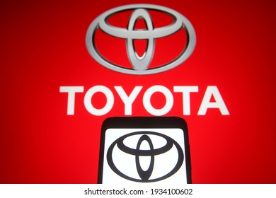 KYIV, UKRAINE - MARCH 10, 2021:  In this photo illustration Toyota Motor Corporation of a Japanese multinational automotive manufacturer is seen on a mobile phone and a computer screen.