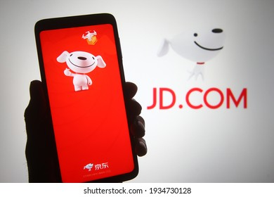 KYIV, UKRAINE - MARCH 12, 2021: In this photo illustration JD.com, Inc. logo of a Chinese e-commerce company is seen on a mobile phone screen and a display