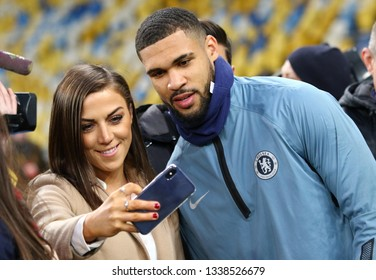 KYIV, UKRAINE - MARCH 13, 2019: Football fan makes selfie portrait with player Ruben Loftus-Cheek of Chelsea during the training session before the UEFA Europa League game against FC Dynamo Kyiv