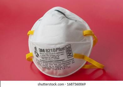 Kyiv, Ukraine - March 13 2020: Novel Coronavirus outbreak concept. 3M respiratory mask. Hospital or pollution protect face masking.