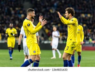 Kyiv, Ukraine - March 14, 2019: Olivier Giroud and Marcos Alonso of Chelsea celebrates scoring a goal during UEFA Europa League match against Dynamo Kyiv at NSC Olimpiyskiy stadium.