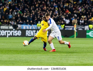 Kyiv, Ukraine - March 14, 2019: N`golo Kante of Chelsea fighting for the ball with Volodymyr Shepelev of Dynamo Kyiv during UEFA Europa League match at NSC Olimpiyskiy stadium.