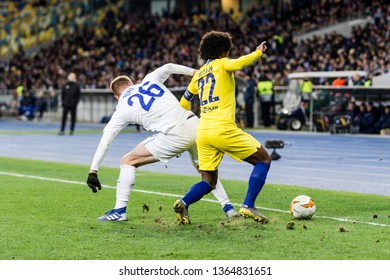 Kyiv, Ukraine - March 14, 2019: Willian of Chelsea fighting for the ball with Mykyta Burda of Dynamo Kyiv during UEFA Europa League match at NSC Olimpiyskiy stadium.