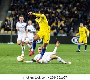 Kyiv, Ukraine - March 14, 2019: Ruben Loftus-Cheek of Chelsea fighting for the ball with Tomasz Kedziora of Dynamo Kyiv during UEFA Europa League match at NSC Olimpiyskiy stadium.