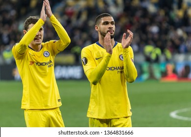Kyiv, Ukraine - March 14, 2019: Ruben Loftus-Cheek and Marcos Alonso of Chelsea by the end of UEFA Europa League match against Dynamo Kyiv at NSC Olimpiyskiy stadium.