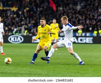 Kyiv, Ukraine - March 14, 2019: Mateo Kovacic of Chelsea fighting for the ball with Mykyta Burda of Dynamo Kyiv during UEFA Europa League match at NSC Olimpiyskiy stadium.