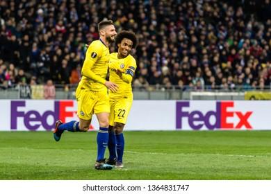 Kyiv, Ukraine - March 14, 2019: Olivier Giroud and Willian of Chelsea celebrates scoring a goal during UEFA Europa League match against Dynamo Kyiv at NSC Olimpiyskiy stadium.