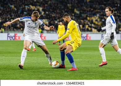 Kyiv, Ukraine - March 14, 2019: Ruben Loftus-Cheek of Chelsea fighting for the ball with Serhiy Sydorchuk of Dynamo Kyiv during UEFA Europa League match at NSC Olimpiyskiy stadium.