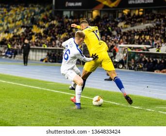 Kyiv, Ukraine - March 14, 2019: Ruben Loftus-Cheek of Chelsea fighting for the ball with Mykyta Burda of Dynamo Kyiv during UEFA Europa League match at NSC Olimpiyskiy stadium.
