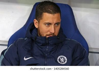 KYIV, UKRAINE - MARCH 14, 2019: Chelsea leader Eden Hazard seats on a bench during the UEFA Europa League game against FC Dynamo Kyiv at NSC Olimpiyskyi stadium in Kyiv, Ukraine