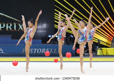 """KYIV, UKRAINE - MARCH 16, 2019: Team of RUSSIA performs with 5 Balls during Group Competition of Rhythmic Gymnastics Grand Prix """"Deriugina Cup"""" in Palace of Sports in Kyiv, Ukraine"""