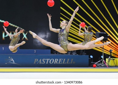 """KYIV, UKRAINE - MARCH 16, 2019: Team of UKRAINE performs with 5 Balls during Group Competition of Rhythmic Gymnastics Grand Prix """"Deriugina Cup"""" in Palace of Sports in Kyiv, Ukraine"""