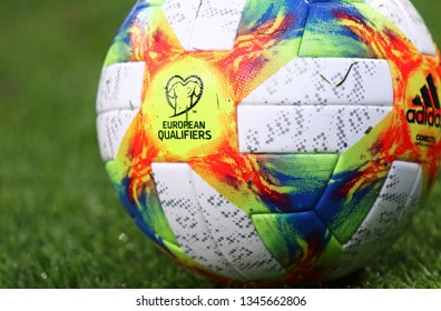 KYIV, UKRAINE - MARCH 18, 2019: Official UEFA EURO-2020 Qualifiers match ball Adidas Conext19 on the grass during the Open training session of Ukraine National Football Team at NSC Olimpiyskyi stadium