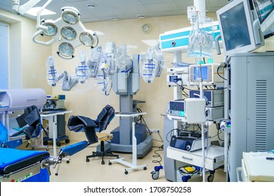 KYIV, UKRAINE - March 2020: Surgical room in hospital with robotic technology equipment, machine arm surgeon in futuristic operation room. Minimal invasive surgical innovation