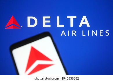 KYIV, UKRAINE - MARCH 21, 2021: In this photo illustration Delta Air Lines, Inc., typically referred to as Delta, is one of the major airlines of the United States is seen on a mobile phone and a comp