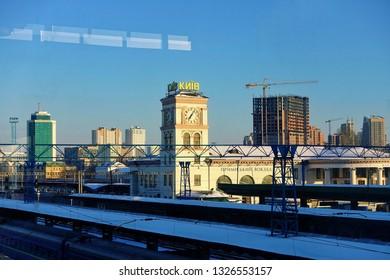 KYIV, UKRAINE - MARCH 22, 2018: train tracks and trains at the Kyiv-Pasazhyrskyi railway station.