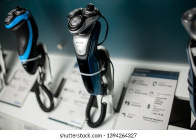 Kyiv, Ukraine - March 24, 2018: Philips electric shavers stand on a shelf in a supermarket. Electric shavers Philips