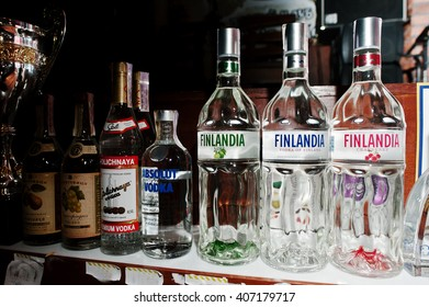 KYIV, UKRAINE - MARCH 25, 2016: Various alcoholic beverages bottles in the bar. Finlandia Finland vodka at center