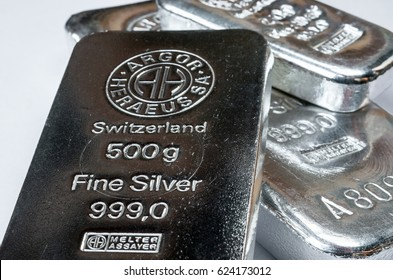 Kyiv, Ukraine - March 27, 2017: several silver bars of different weight produced at the Swiss factory Argor-Heraeus - is one of the world's largest processors of precious metals. Selective focus.